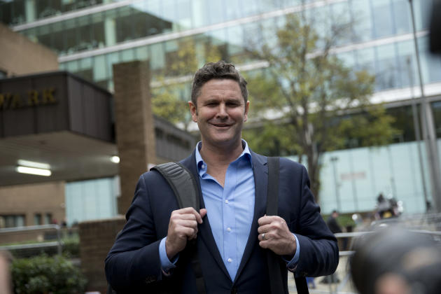 Former New Zealand cricket captain Chris Cairns stops to pose for photographers as he leaves after being found not-guilty in his perjury trial at Southwark Crown Court in London, Monday, Nov. 30, 2015