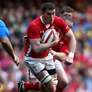 Ian Evans is sidelined for Wales' clash with Australia on Saturday due to a knee injury