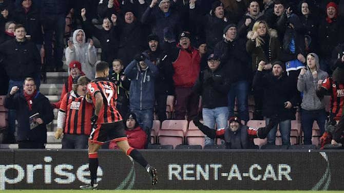 Bournemouth's Joshua King celebrates scoring their first goal in front of fans