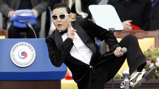 "FILE - In this Feb. 25, 2013 file photo, South Korean rapper PSY performs before President Park Geun-hye's presidential inauguration ceremony at the National Assembly in Seoul, South Korea. Sporting a black suit and a sleek haircut, a 7-year-old boy, Hwang Min-woo performed at a news conference in South Korea on Wednesday, March 6, 2013. The impish boy nicknamed ""Little PSY"" is releasing an electro pop song next week through iTunes. Min-woo says he wants to gain global fame like his ""big brother,"" PSY. (AP Photo/Lee Jin-man, FIle)"