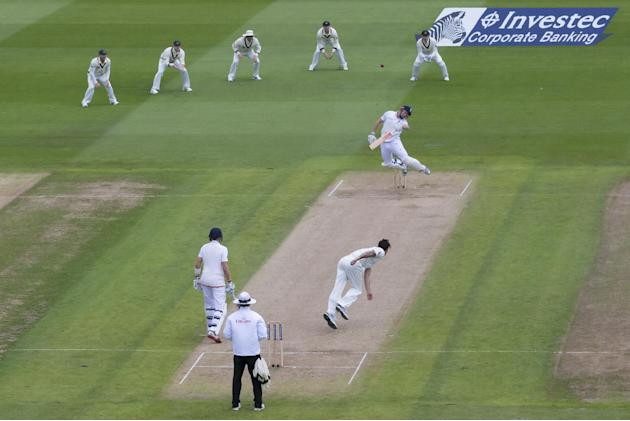 England's Jonny Bairstow, upper centre right, reels away from as bouncer as he looses his wicket for 5 off the bowling of Australia's Mitchell Johnson, lower centre right, on the second day of