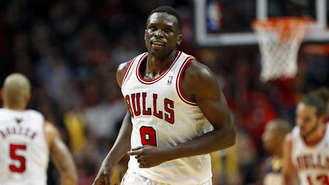 Chicago Bulls forward Luol Deng gestures after scoring against the Indiana Pacers during the second half of an NBA basketball game in Chicago, Saturday, Nov. 16, 2013. The Bulls won 110-94