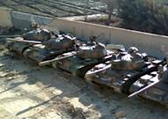 A handout picture released by Shaam News Network purportedly shows Syrian army tanks hidden inside a schoolyard before the arrival of the UN monitors to the city of Deir al-Zor. Syrian troops killed 28 civilians in the central city of Hama, monitors said, as UN military observers toured protest centres near the capital and both the European Union and the United States imposed new sanctions