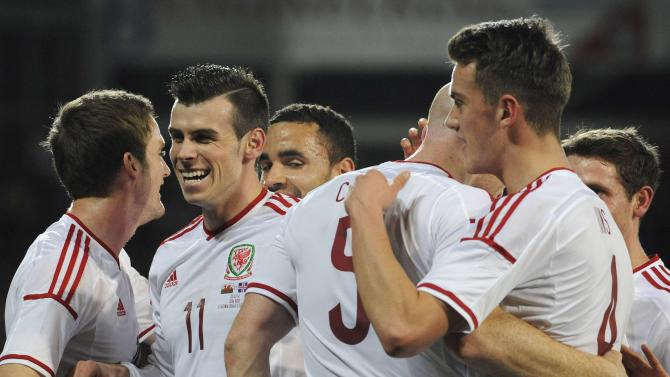 Wales' Gareth Bale celebrates after team mate James Collins scored a goal during the friendly international soccer match at Cardiff City Stadium in Cardiff