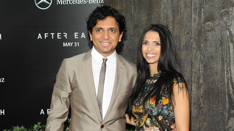 "Director M. Night Shyamalan and his wife Bhavna attend the ""After Earth"" premiere at the Ziegfeld Theatre on Wednesday, May 29, 2013 in New York. (Photo by Evan Agostini/Invision/AP)"