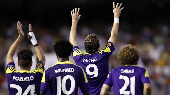 Swansea City's Michu from Spain, second right, celebrates after scoring against Valencia during their Europa League Group A soccer match at the Mestalla stadium in Valencia, Spain, Thursday, Sept. 19, 2013