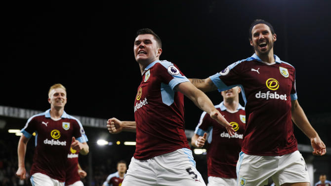 Burnley's Michael Keane celebrates scoring their second goal with George Boyd and teammates