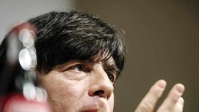 Germany's soccer coach Joachim Loew attends a press conference in Stockholm, Sweden, Monday Oct. 14, 2013, ahead of their 2014 World Cup qualifier match against Sweden on Tuesday