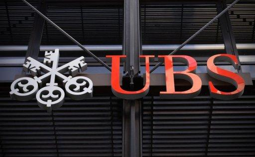 Swiss bank UBS logo outside the company offices in the City of London in October. UBS was non-commital on Monday after a newspaper reported it may pay more than $450 million (350 million euros) to US and British authorities to settle allegations that it manipulated Libor interest rates.