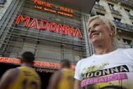 Fans of Madonna outside the Olympia concert hall in Paris wait for her show on Thursday. The singer was on the receiving end of an angry backlash from her fans on Friday for ending a Paris concert after just 45 minutes