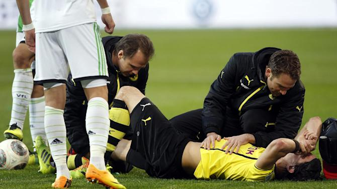 Dortmund's player Neven Subotic of Serbia receives medical treatment during the German first division Bundesliga soccer match between VfL Wolfsburg and Borussia Dortmund in Wolfsburg, Germany, Saturday, Nov. 9, 2013