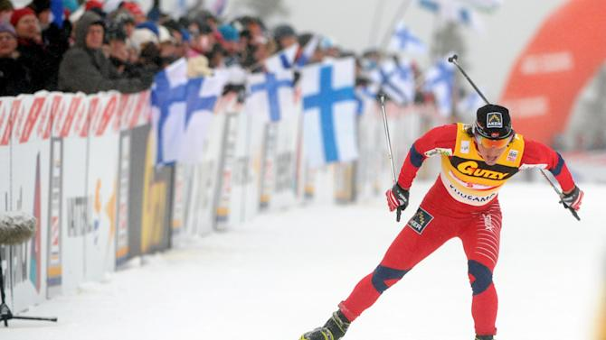 Norway's Marit Björgen skis to win ladies individual 5 km free style cross country skiing event during the FIS World Cup Ruka Nordic Opening in Kuusamo, Finland, on Saturday Nov. 26, 2011. (AP Photo / LEHTIKUVA, Heikki Saukkomaa)  FINLAND OUT - NO SALES