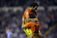 Barcelona's Lionel Messi (R) celebrates with Cesc Fabregas after scoring during their Spanish La Liga match against Deportivo, at Riazor Stadium in Coruna, on October 20. Barcelona visit Rayo Vallecano next, on Saturday