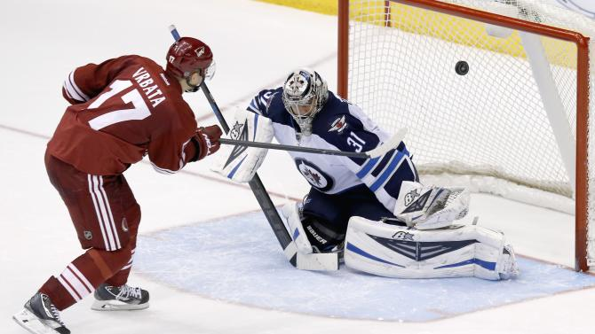 Phoenix Coyotes' Radim Vrbata (17), of the Czech Republic, gets his shot knocked away by Winnipeg Jets' Ondrej Pavelec (31), of the Czech Republic, during the shootout of an NHL hockey game, Tuesday, April 1, 2014, in Glendale, Ariz. The Jets defeated the Coyotes 2-1