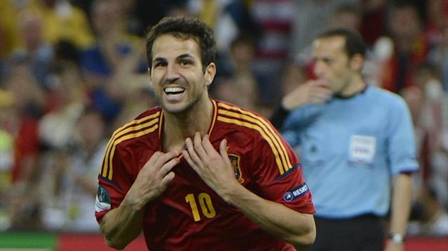 Spanish midfielder Cesc Fabregas celebrates after scoring a penalty shoot out during the Euro 2012 football championships semi-final match Portugal vs Spain on June 27, 2012 at the Donbass Arena in Donetsk