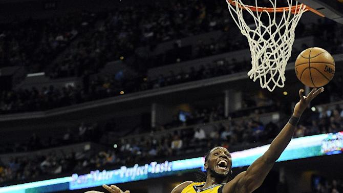 Chicago Bulls forward Carlos Boozer, left, fouls Denver Nuggets forward Kenneth Faried, right, in the second half of an NBA basketball game on Thursday, Nov. 21, 2013, in Denver. The Nuggets won 97-87