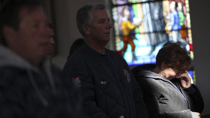 Maryann Eger cries during Mass in the New Dorp neighborhood of Staten Island, N.Y., Sunday, Nov. 4, 2012, as the region copes in the aftermath of Superstorm Sandy. (AP Photo/Seth Wenig)