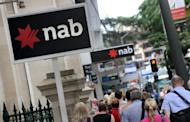 The National Australia Bank in Brisbane. National Australia Bank announced a 15.5 percent slump in first-half net profit Thursday due to a poor performance at its embattled British operations