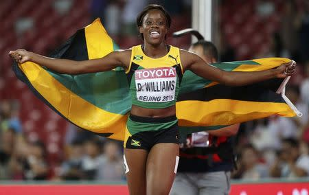 Williams of Jamaica reacts after winning the women's 100m hurdles during the 15th IAAF World Championships at the National Stadium in Beijing
