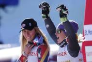 Alpine Skiing - FIS Alpine Skiing World Championships - Women's Giant Slalom - St. Moritz, Switzerland - 16/2/17 - Gold medalist Tessa Worley (R) of France celebrates as silver medalist Mikaela Shiffrin of the USA looks on during the flower ceremony. REUTERS/Denis Balibouse