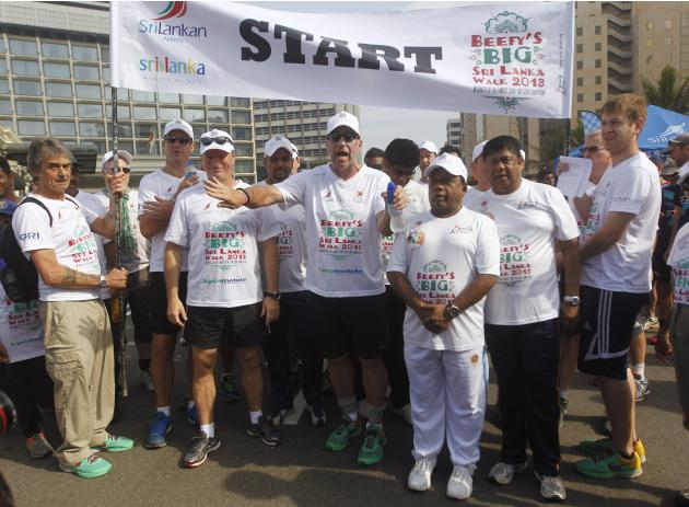Former England cricket captain Botham takes part in his charity walk in Colombo