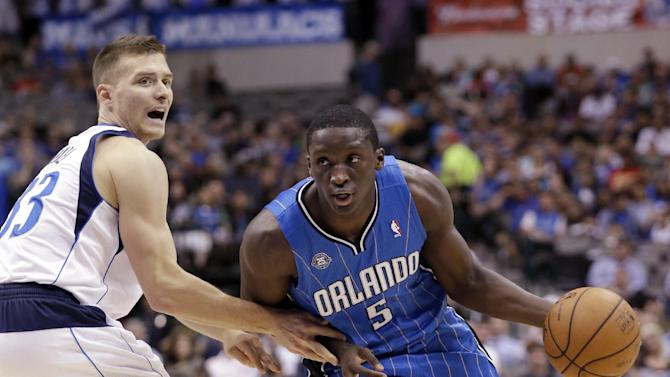 Orlando Magic shooting guard Victor Oladipo (5) drives past Dallas Mavericks point guard Gal Mekel (33) of Israel during the first half of an NBA preseason basketball game in Dallas,  Monday, Oct. 14, 2013