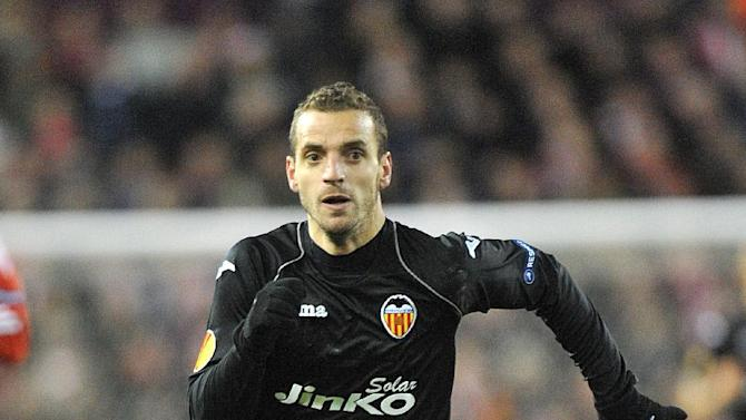 Roberto Soldado's hat-trick helped Valencia move joint on points with two other teams in Group F