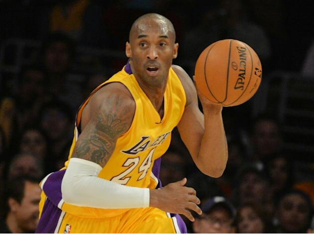 Kobe Bryant of the Los Angeles Lakers drives against the Memphis Grizzlies during their NBA game at the Staples Center in Los Angeles, California on January 2, 2015