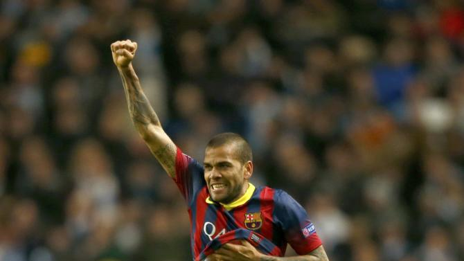 Barcelona's Dani Alves celebrates after scoring Barcelona's second goal against Manchester City during their Champions League round of 16 first leg soccer match at the Etihad Stadium in Manchester,