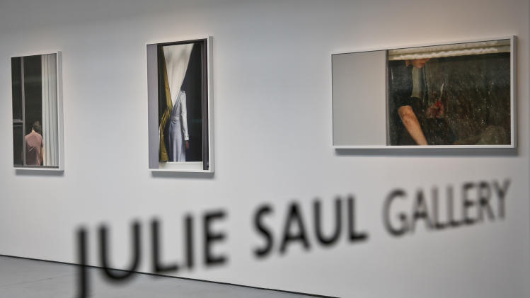 Photography of Arne Svenson hangs inside the Julie Saul Gallery on Thursday, May 16, 2013 in New York.  Residents of a New York luxury apartment building are upset over the exhibition by Svenson who  secretly made their pictures from his window across the street. (AP Photo/Bebeto Matthews)