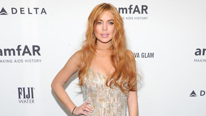 """FILE - This Feb. 6, 2013 file photo shows actress Lindsay Lohan attending amfAR's New York gala at Cipriani Wall Street in New York. Lohan will be a guest on """"Late Show with David Letterman"""" next week. CBS says she will pay Dave a visit on the April 9 telecast. It will be her first """"Late Show"""" appearance in six years. Lohan is promoting her guest appearance on the FX sitcom """"Anger Management,"""" which will air two days later. On that episode, she will be playing herself but as a therapy patient of series star Charlie Sheen. (Photo by Evan Agostini/Invision/AP, file)"""