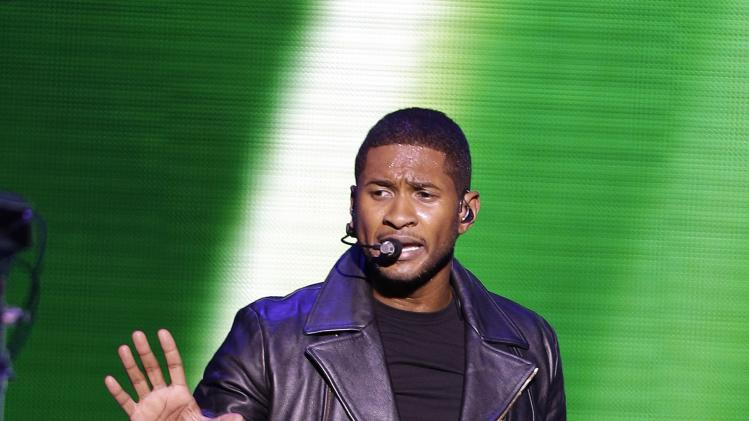 "Usher performs during the Kids' Inaugural: Our Children. Our Future."" event in Washington, Saturday, Jan. 19, 2013.  (AP Photo/Frank Franklin II)"