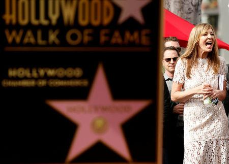Actress Janney waits before unveiling her star on the Hollywood Walk of Fame in Los Angeles