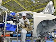 A worker is seen assembling parts to the new model of Toyota Motor's best selling car 'Corolla' at a plant of the company's subsidiary in Miyagi prefecture, northern Japan, on May 11. Japan's economy grew by 1.0 percent in the January to March quarter compared with the previous three months, according to the latest official data, as the world's third-largest economy mounts a slow recovery