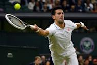 Serbia's Novak Djokovic plays a forehand shot during his fourth round men's singles victory over compatriot Viktor Troicki on day seven of the 2012 Wimbledon Championships at the All England Tennis Club in Wimbledon, southwest London. Djokovic won 6-3, 6-1, 6-3
