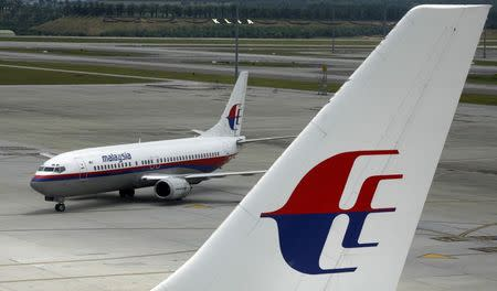An aircraft of Malaysian Airline System taxis on the tarmac at Kuala Lumpur International Airport in Sepang in this February 26, 2007 file photo. REUTERS/Bazuki Muhammad/Files
