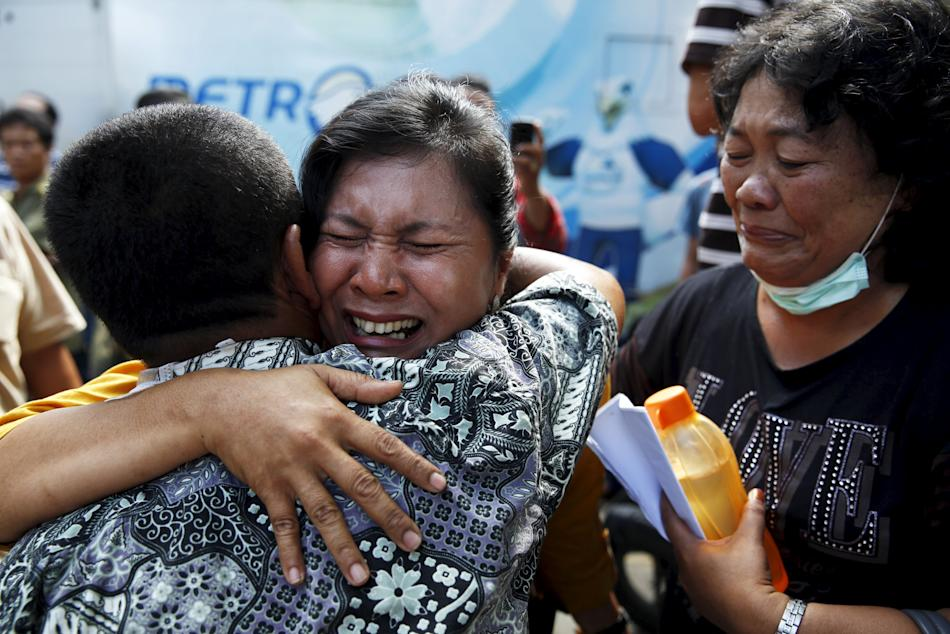 A woman cries after confirming that her brother was among the victims of an Indonesian military C-130 Hercules transport plane that crashed into a residential area, outside the Adam Malik hospital in