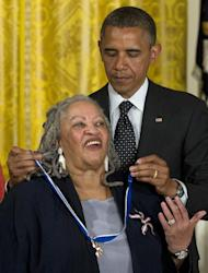 President Barack Obama awards author Toni Morrison with a Medal of Freedom, Tuesday, May 29, 2012, during a ceremony in the East Room of the White House in Washington. (AP Photo/Carolyn Kaster)