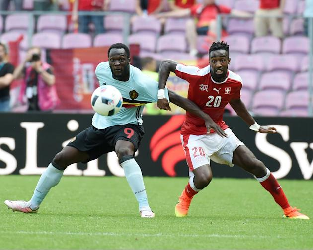 Belgium's forward Romelu Lukaku (L) vies with Switzerland's defender Johan Djourou (R) during the friendly football match on May 28, 2016, in Geneva