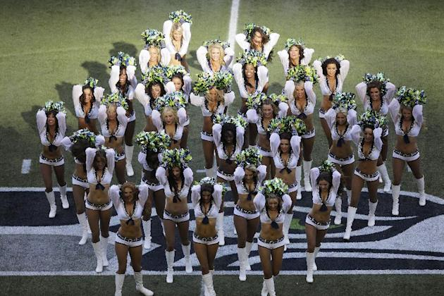 Seattle Seahawks Sea Gals cheerleaders perform before the start of an NFL football game between the Seattle Seahawks and the Green Bay Packers, Thursday, Sept. 4, 2014, in Seattle. (AP Photo/Scott Ekl