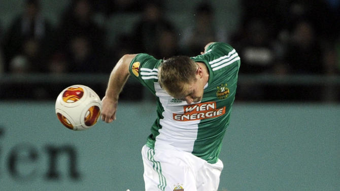 Rapid's Mario Sonnleitner, top, and Genk's Jelle Vossen challenge for the ball during their Europa League group G soccer match between SK Rapid Vienna  and KRC Genk, in  Vienna, Austria, Thursday, Nov. 7, 2013