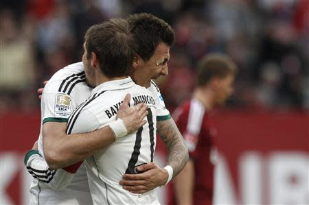 Bayern Munich's Mandzuzkic and Lahm celebrate a goal during German Bundesliga soccer match against Nuremberg in Nuremberg