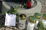 Memorial letter, candles and rose lie at the shooting place in at Uudenmaankatu in Hyvinkaa. Two people were killed and seven wounded by the killer who shot people from a roof in the Hyvinkaa city centre. Police arrested Saturday an 18-year-old man