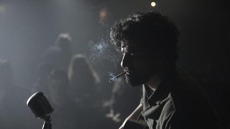 "This film image released by CBS FIlms shows Oscar Isaac in a scene from ""Inside Llewyn Davis."" (AP Photo/CBS FIlms, Alison Rosa)"