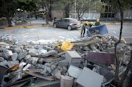 Soldiers, federal policemen and firefighters remove debris from the headquarters of state-owned Mexican oil giant Pemex in Mexico City on February 1, 2013