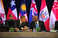 US President Barack Obama speaks to US Trade Representative Ron Kirk (R) at a meeting of Trans Pacific Partnership (TPP) leaders in Honolulu in November 2011. A protest aimed at disrupting TPP talks in New Zealand turned violent as demonstrators attacked security forces, police said