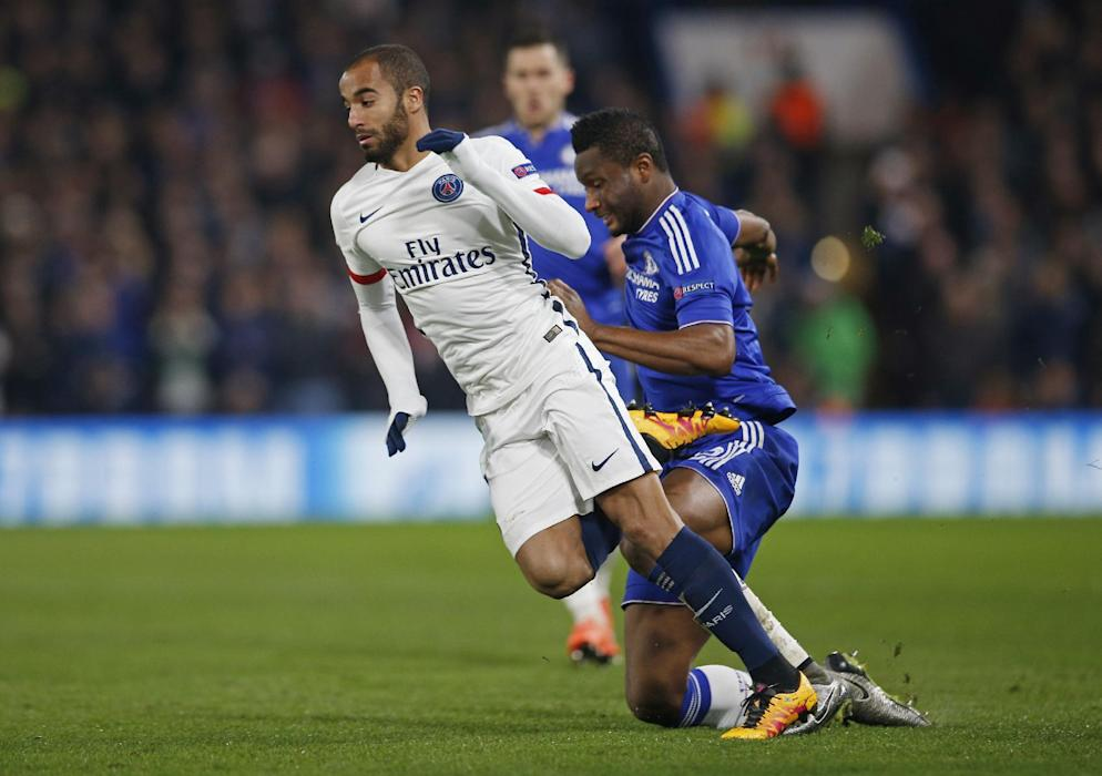 Chelsea's John Obi Mikel fouls PSG's Lucas Moura. He was  subsequently shown a yellow card