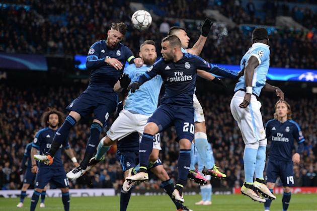 Real Madrid's defender Sergio Ramos (L), Manchester City's defender Nicolas Otamendi (2L) and Real Madrid's forward Jese Rodriguez (3L) go up for a header during the UEFA Champions League