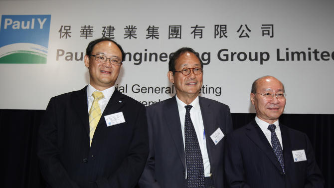 From left, Paul Y. Engineering Ltd. Executive Director and CEO Stanley Wong Kam-cheong, Chairman James Chiu and Deputy Chairman Tom Lau Ko-yuen smile during their company's special general meeting in Hong Kong Tuesday, Nov. 15, 2011. Shareholders of the Hong Kong construction company Tuesday approved a $220.5 million investment in a Hollywood-China movie production joint venture aimed at China's increasingly lucrative film market. (AP Photo/Kin Cheung)