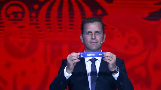 "Former German soccer player Bierhoff  holds up the slip showing ""Romania"" during the preliminary draw for the 2018 FIFA World Cup at Konstantin Palace in St. Petersburg"